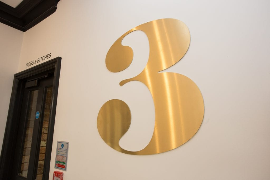 Gold metal floor numbering